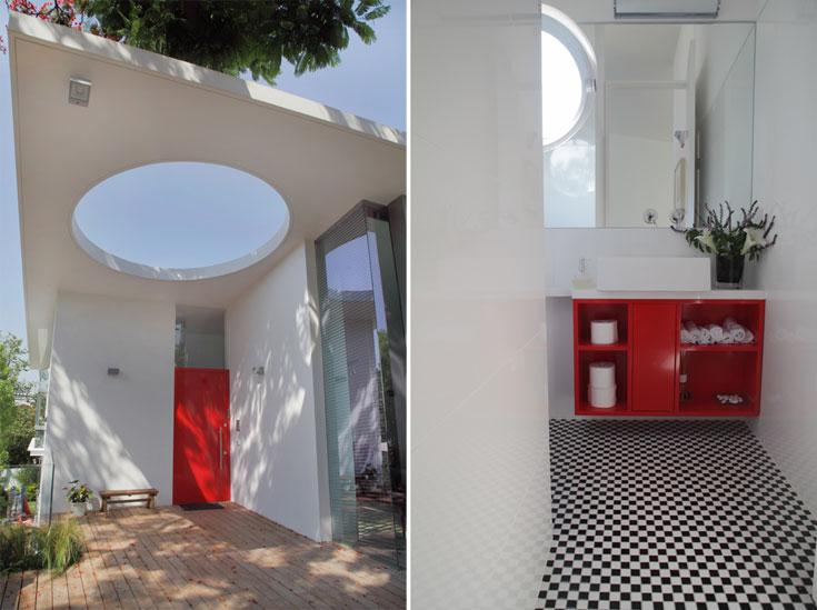 מוטיבים כמו הפתח העגול והצבע האדום חוזרים גם בתוך הבית, כמו בשירותי האורחים שבתמונה מימין (צילום: אמית הרמן)