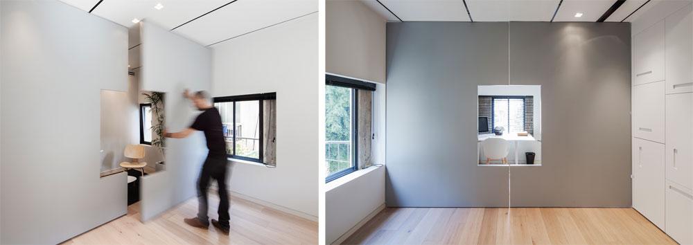 מחיצת עץ אפורה בחדר העבודה ניתנת להסטה בעזרת חריצים בתקרה. כשהיא צמודה לקיר חדר הרחצה מתקבל חדר עבודה רחב ידיים, אבל אפשר בקלות לשחק עם גודל החללים (צילום: אביעד בר נס)