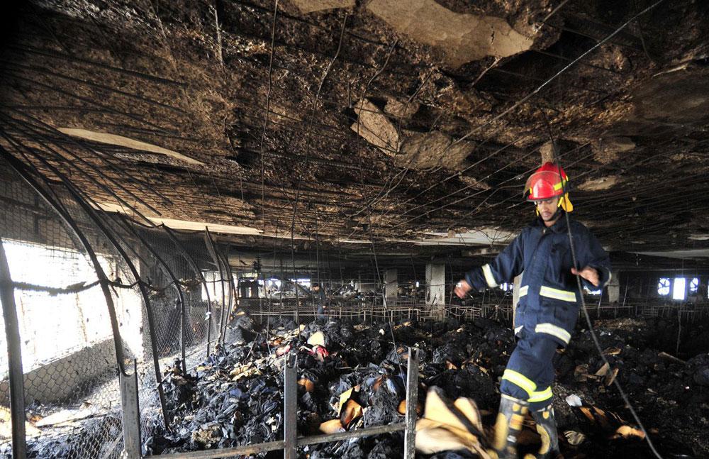 אסון קודם במפעל טקסטיל בבנגלדש, 2010 (צילום: rex/asap creative)