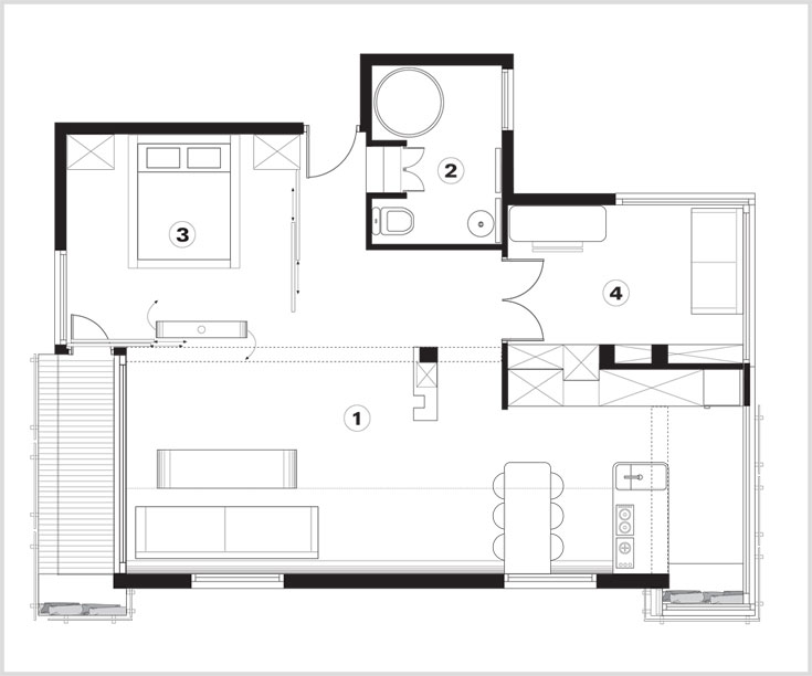 תוכנית הדירה: למעלה במרכז הכניסה. מצידיה חדר שינה וחדר רחצה, שמעבר לו חדר עבודה. במקביל להם החלל המרכזי הפתוח, שבו סלון ומטבח