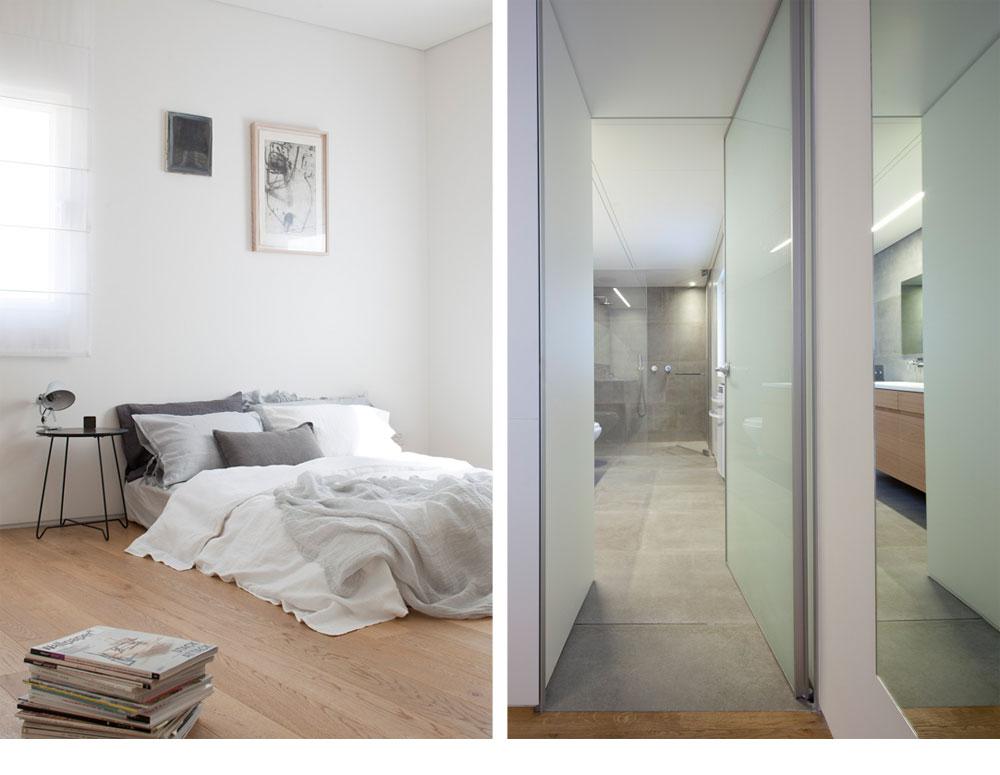 חדר רחצה בצבעי בטון (מימין), הצמוד לחדרם של ההורים (משמאל), שעוצב בסגנון זרוק, עם מזרון נמוך על הרצפה (צילום: עמית גירון)