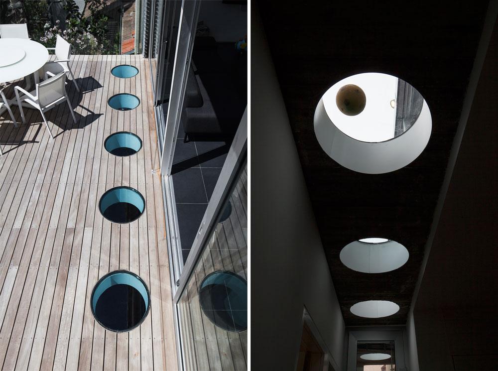 לקורת הבטון עם החלונות העגולים כמה סיבות: היא תומכת את המרפסת, מאירה את הקומה התחתונה, בולטת כאלמנט אסתטי - ומשמשת כר משחק לילדות, שמציצות זו בזו (צילום: אביעד בר נס)