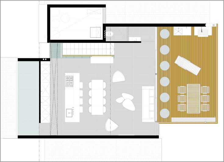 תוכנית הקומה העליונה: חלל פתוח שבו מטבח, פינת אוכל וסלון, ומרפסת גדולה. שימו לב לחלונות העגולים (תכנון: ארכ' עדי וינברג, ארביג'אז)