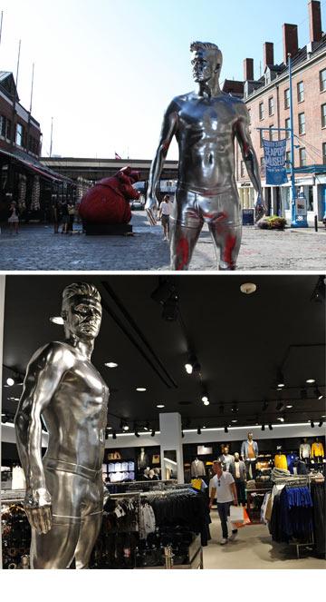 משתלט על המרחב העירוני. הפסל של בקהאם ברחוב ובחנות של H&M (צילום: gettyimages)
