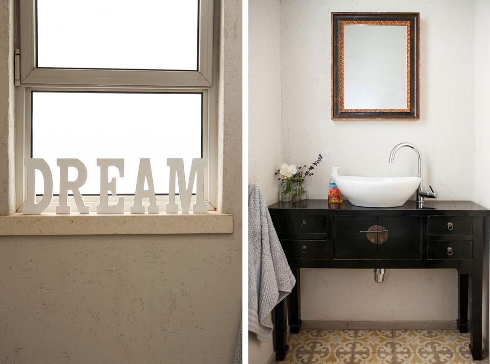 שירותי האורחים נצבעו בטיח וגה, ללא חיפוי באריחים. הכיור הונח על ארון סיני צבוע בשחור (''Uma'')  (צילום: שירן כרמל )