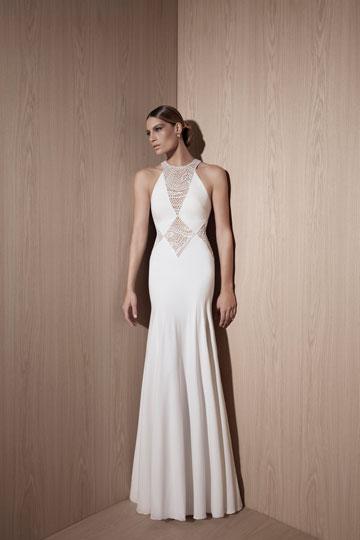 """שמלת כלה בעיצובו של רונן פראצ'ה. """"זה לא סוד מדינה, כל תעשיית האופנה על הפנים, בטח בתחום החתונות""""  (צילום: דודי חסון)"""