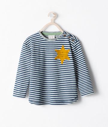 חולצת השריף מקולקציית הילדים של זארה לקיץ 2014, אשר הוסרה מהמדפים לאחר שעוררה סערה ציבורית (מתוך: zara.com)