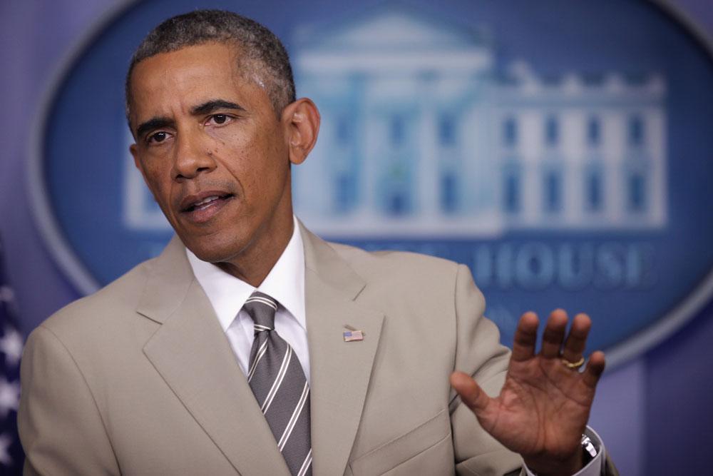 ברק אובמה והחליפה הבהירה. עורר פולמוס זועם-נרגש (צילום: gettyimages)