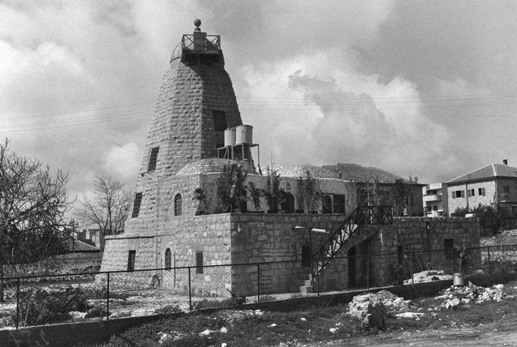 11. התמונה הזו צולמה ב-1936 באחת הערים שכבר ביקרנו בהן. יש בה מבנה שמזכיר את זה שמופיע בתמונה, רק שהוא יותר מפורסם (צילום: הצלמניה)