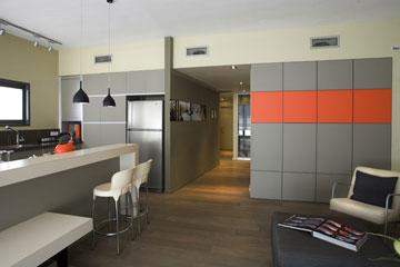 בחירת גוון דומננטי שמהווה רקע לחדר. עיצוב: קרן אטלס-דרור (צילום: גידי בועז)