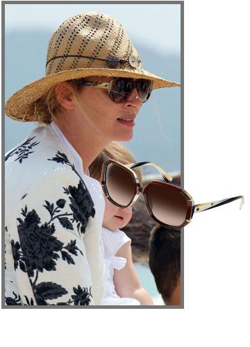 אומה תורמן מחליפה משקפיים כמו גרביים. הזוג התורן הוא מבית לנוון והדגם עוצב במיוחד בשבילה (1,200 שקל) (צילום: splashnews/asap creative)