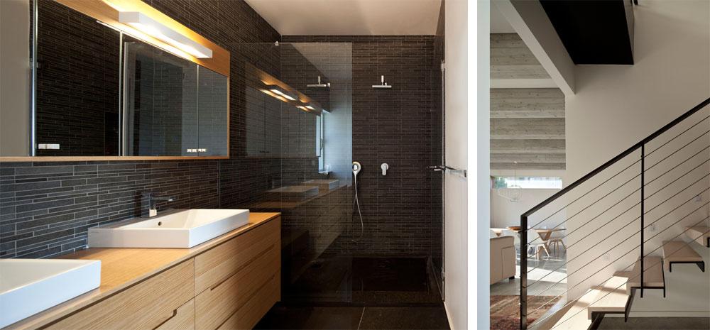 מימין: גרם המדרגות שמוביל לחדרי השינה. משמאל: חדר הרחצה של ההורים קיבל אופי דרמטי: אריחי הרצפה שחורים וכך גם אריחי הפסיפס הדקים על הקירות (צילום: עמית גרון)