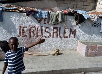 """ילד בהאיטי. """"אני מתקבלת בהמון אהבה"""" (צילום: תמר דרסלר)"""