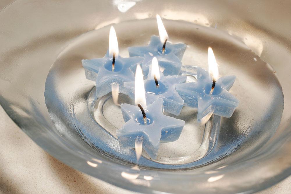 נרות צפים בצורת כוכבים (צילום: ענבל עופר)