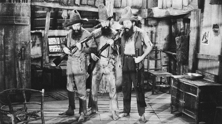 """הברבן הוא צאצא של המונשיין - משקה מחתרתי שזיקקו פושעים בדרום ארה""""ב. סצינה מהסרט """"קנטאקי מונשיין"""" (צילום: gettyimages)"""