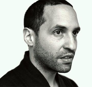 עומר ארבל. נולד בירושלים, גדל וחי בקנדה