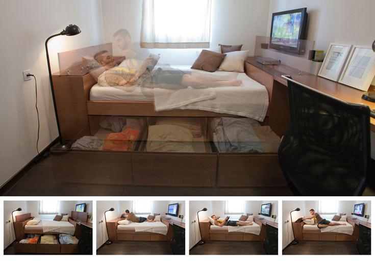 המיטה ולצידה הרהיט הארוך בחדר השינה-עבודה (צילום: גידי בועז)